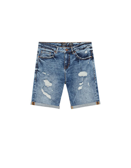 Slim fit denim Bermuda shorts with ripped details