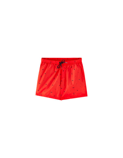 Red swimming trunks with all-over print