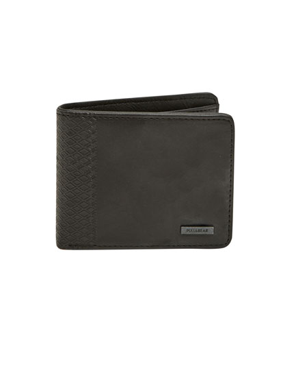 Wallet with geometric embossing on the side