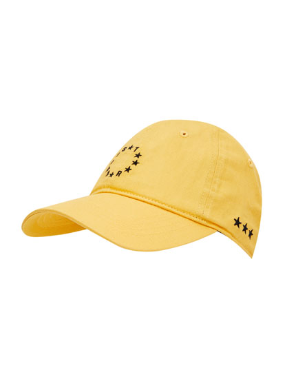Mustard yellow cap with embroidered black stars