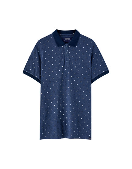 Piqué polo shirt with palm tree print