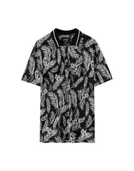 Tropical leaf print polo shirt