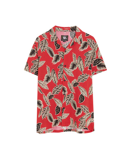 Red short sleeve shirt with leaf print