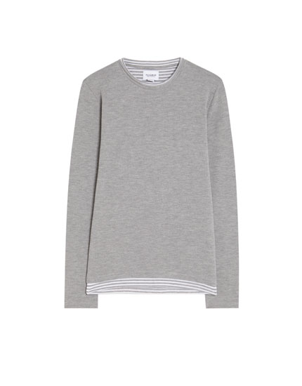 Sweater with printed lining and hem
