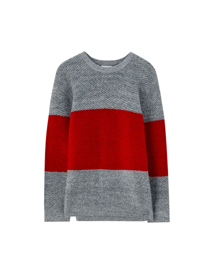 Diagonal knit sweater with red stripe