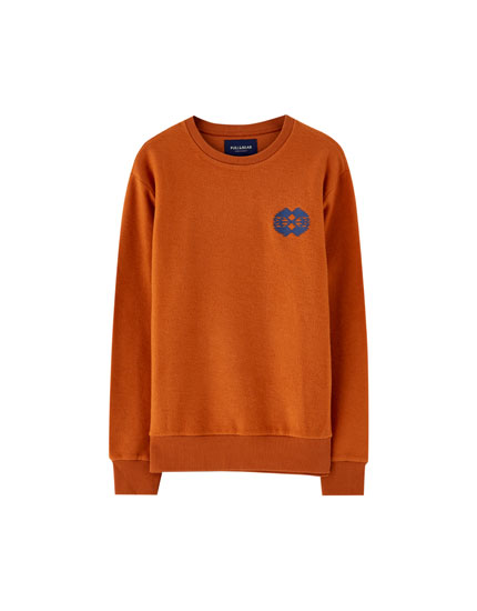 Fleece sweatshirt with patterned embroidery