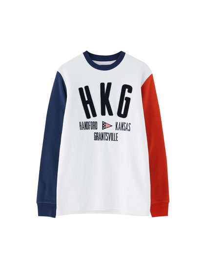Sweatshirt with panelled sleeves and slogan