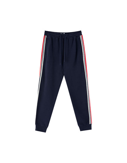 Jogging trousers with side band