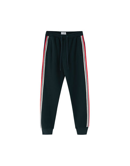 Plush jogging trousers with side stripes