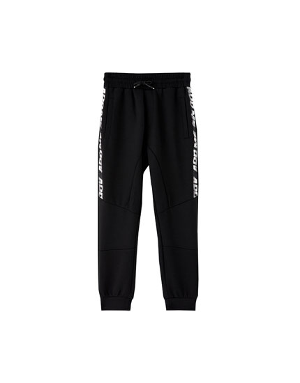 Knit jogging trousers with side slogan taping