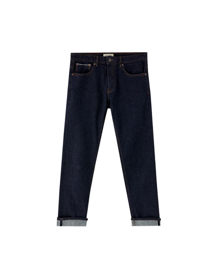 Pantalón denim straight fit orillo