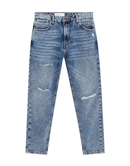 Used jeans met scheuren