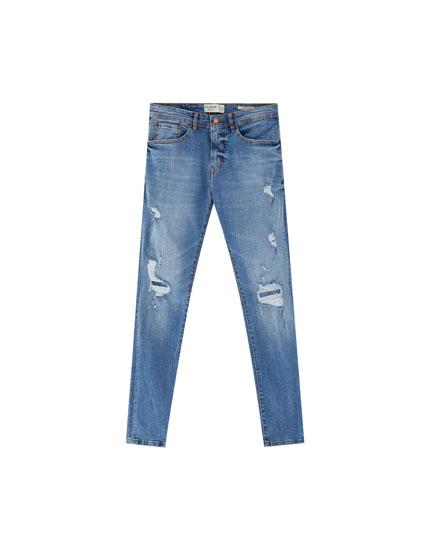 Jeans skinny fit premium con rotos