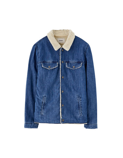 Denim jacket with faux shearling lining and pockets