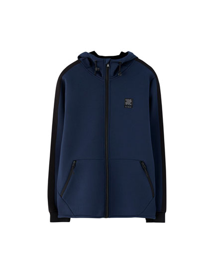 Hooded technical jacket