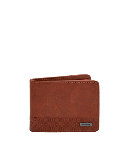 Brown wallet with raised triangle panel