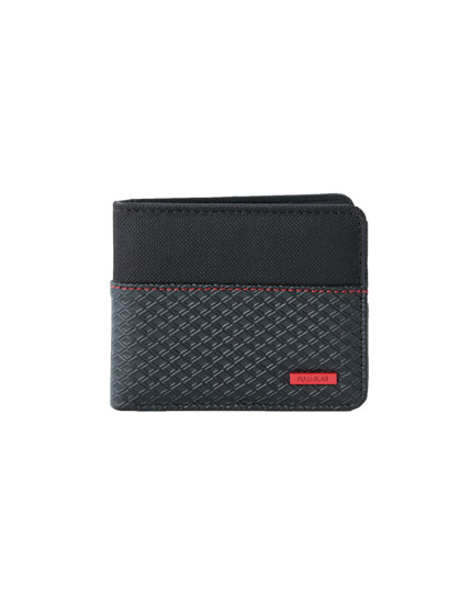 Wallet with raised pattern and red seam