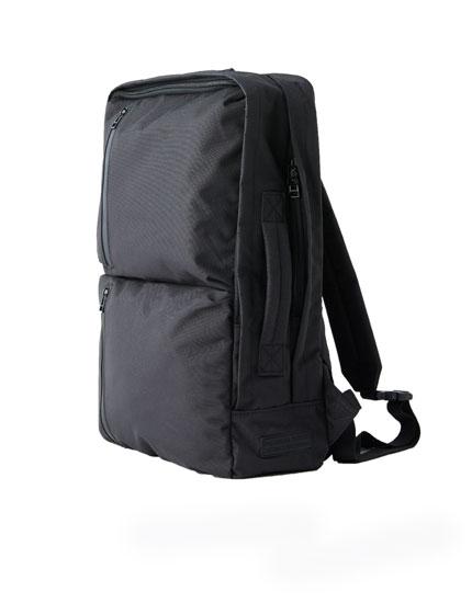 Briefcase-style backpack with pockets