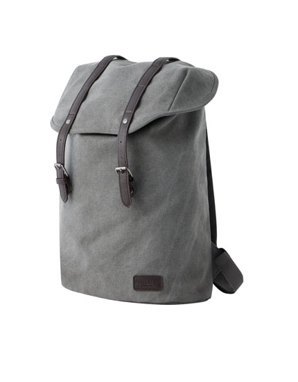 Grey flap backpack with straps