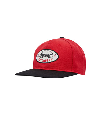 Cap with wolf patch