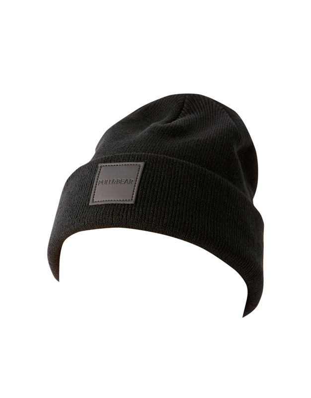 cac3e8064b6 BLACK. BLUE. Return. Knit beanie with rubberised patch