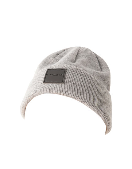 Melange beanie with rubberised patch