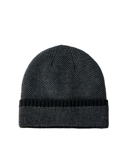 Hat with faux shearling lining