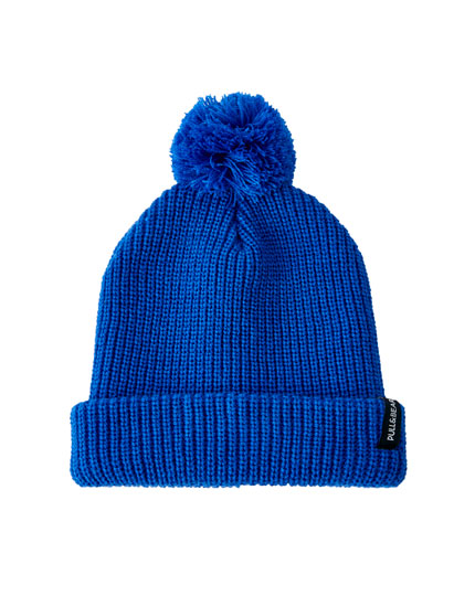 Bright-coloured knit pompom hat