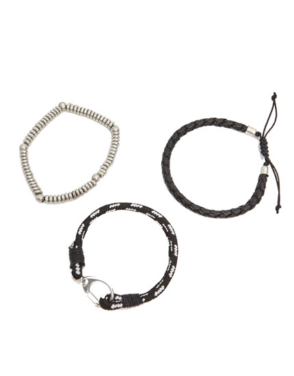 Pack of black and metallic bracelets