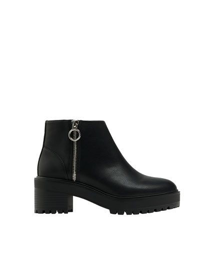 Black ankle boots with zip detail