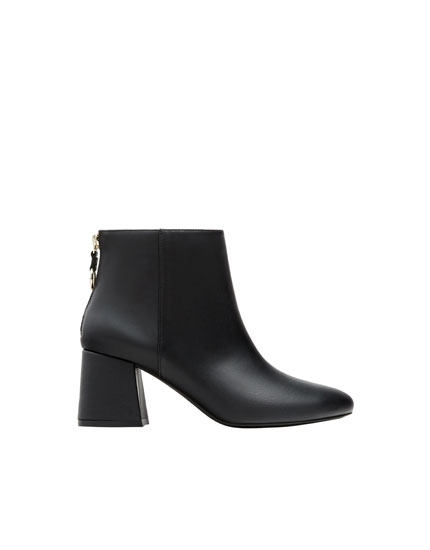 Black ankle boots with heel detail