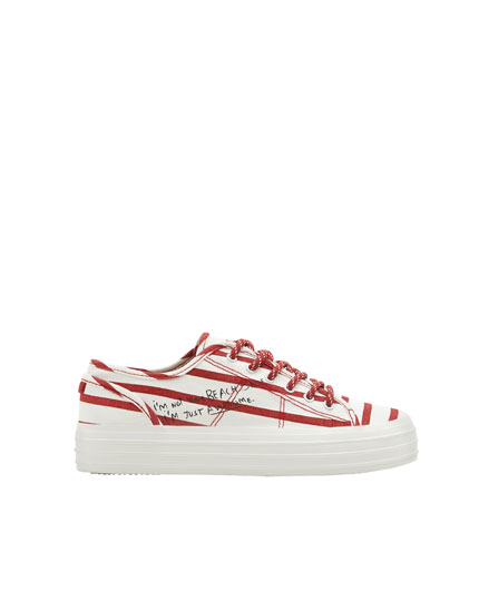 Sneakers with red stripes