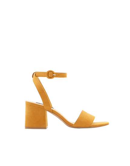 Mustard yellow mid-heel sandals with ankle strap