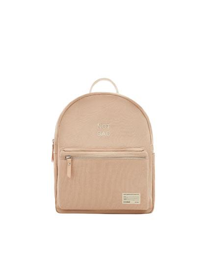Yazılı kumaş ten rengi mini sırt çantası