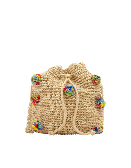 Bucket bag embellished with pompoms