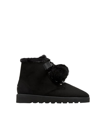 Black winter ankle boots with pompoms
