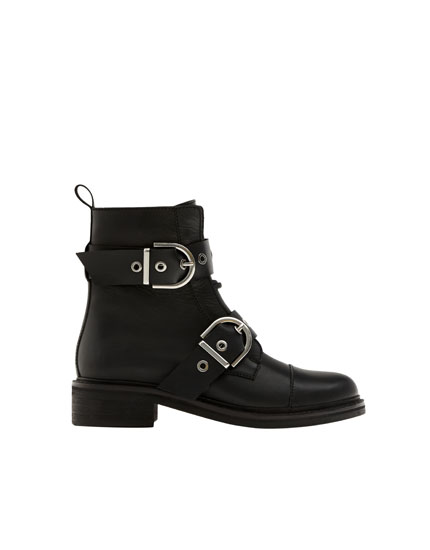 Black leather ankle boots with double buckle