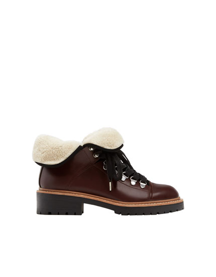 Lace-up ankle boots with faux fur trims