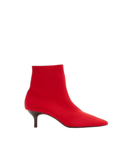 Red fabric high-heel ankle boots