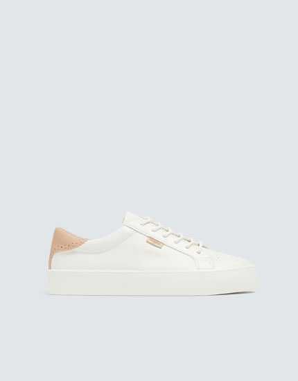 Plimsolls with perforated detailing
