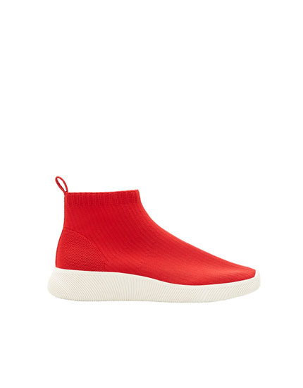 Red sock-style sneakers