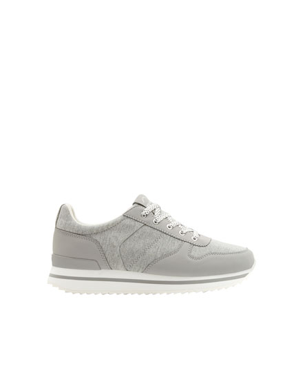 Grey lace-up trainers