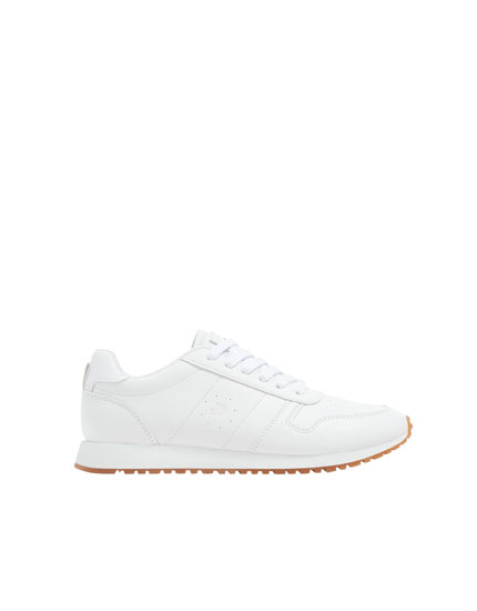 White trainers with embroidery