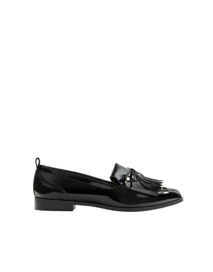 Patent finish loafers with fringe detail
