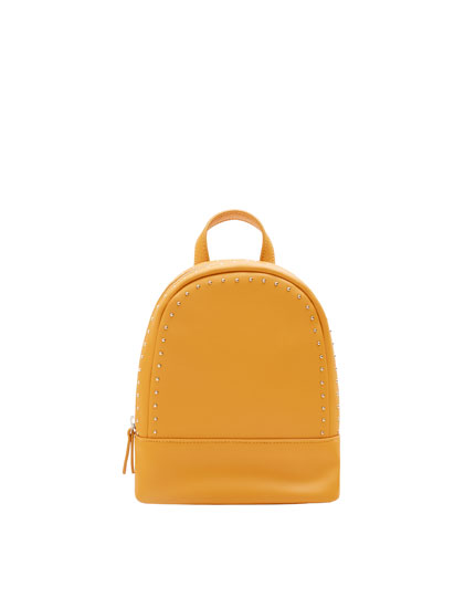 Mustard yellow mini backpack with stud details