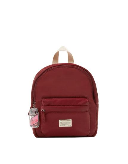 Burgundy backpack with keyring detail
