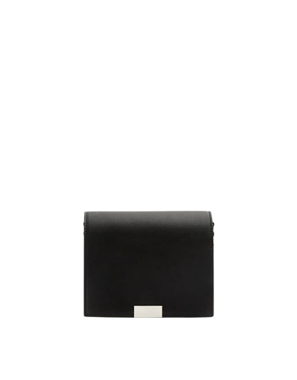 Black crossbody bag with two-tone strap