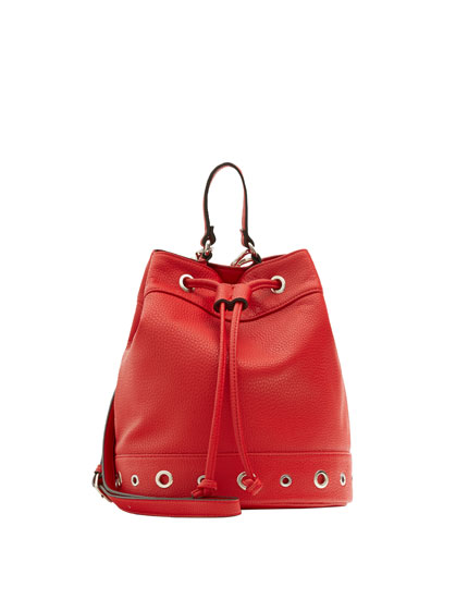 Red bucket bag with grommets