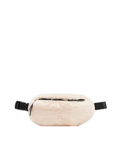 Cream-coloured fuzzy belt bag