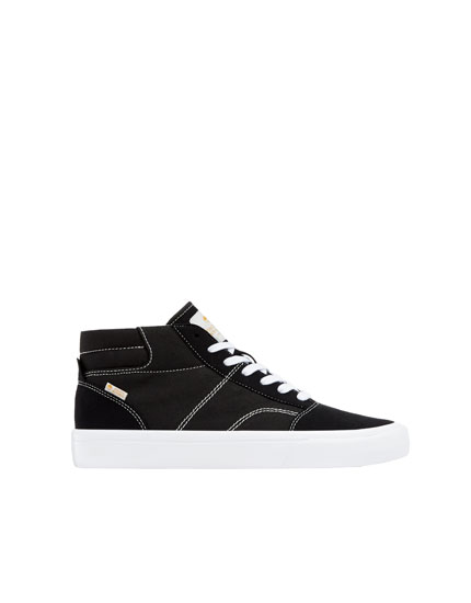 Black high-top teen trainers